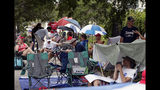 Supporters of President Donald Trump line up on Monday, June 17, 2019, in Orlando, Fla., more that 24 hours before a rally for the presdient. (AP Photo/John Raoux)