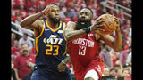 FILE - In this April 17, 2019, file photo, Houston Rockets guard James Harden (13) drives against Utah Jazz forward Royce O'Neale (23) during the first half of Game 2 of a first-round NBA basketball playoff series in Houston. Giannis Antetokuonmpo may have helped his team win 60 games and earn the No. 1 seed in the NBA during the regular season. That's just in the real world, though. In fantasy sports, James Harden was the biggest winner, registering the most points over the 2018-19 season to claim NBA Most Valuable Player honors from DraftKings. (AP Photo/David J. Phillip, File)