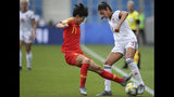 China's Wang Shanshan, left, vies for control of the ball against Spain's Leila Ouahabi during the Women's World Cup Group B soccer match between China and Spain at the Stade Oceane in Le Havre, France, Monday, June 17, 2019. (AP Photo/Francisco Seco)