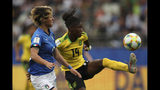 Jamaica's Den-Den Blackwood, right, controls the ball next to Italy's Valentina Giacinti during the Women's World Cup Group C soccer match between Italy and Jamaica at the Stade Auguste-Delaune in Reims, France, Friday, June 14, 2019. (AP Photo/Francisco Seco)