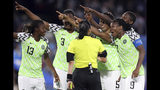 Nigeria players points towards the electronic screen as they protest a yellow card and a penalty awarded against their goalkeeper Chiamaka Nnadozie by Melissa Borjas of Honduras, middle, during the Women's World Cup Group A soccer match between Nigeria and France at the Roazhon Park in Rennes, France, Monday, June 17, 2019. (AP Photo/Vincent Michel)
