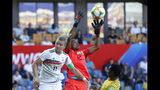 South Africa goalkeeper Andile Dlamini, center, catches the ball against Germany's Alexandra Popp during the Women's World Cup Group B soccer match between South Africa and Germany at the Stade de la Mosson in Montpellier, France, Monday, June 17, 2019. (AP Photo/Claude Paris)