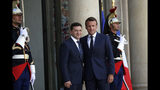 French President Emmanuel Macron, right, greets Ukrainian President Volodymyr Zelenskiy before a meeting at the Elysee Palace, in Paris, Monday, June 17, 2019. (AP Photo/Christophe Ena)