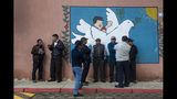 People line up to vote at a polling station in Sumpango, Guatemala, Sunday, June 16, 2019. Guatemalans are voting for their next president Sunday in elections plagued by widespread disillusion and distrust, and as thousands of their compatriots flee poverty and gang violence to seek a new life in the United States. (AP Photo/Moises Castillo)