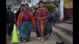 Indigenous women arrive at a polling station in Sumpango, Guatemala, Sunday, June 16, 2019. Guatemalans vote for their next president Sunday in elections plagued by widespread disillusion and distrust, and as thousands of their compatriots flee poverty and gang violence to seek a new life in the United States. (AP Photo/Moises Castillo)