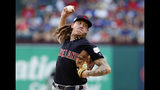 Cleveland Indians starting pitcher Mike Clevinger throws to the Texas Rangers in the first inning of baseball game in Arlington, Texas, Monday, June 17, 2019. (AP Photo/Tony Gutierrez)