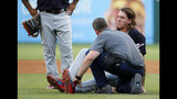 A member of the Cleveland Indians staff checks on starting pitcher Mike Clevinger, right, who fell off the mound while delivering a pitch to the Texas Rangers in the second inning of baseball game in Arlington, Texas, Monday, June 17, 2019. Clevinger continued playing in the game. (AP Photo/Tony Gutierrez)