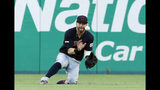 Cleveland Indians right fielder Tyler Naquin makes a sliding catch on a flyout by Texas Rangers' Delino DeShields in the third inning of baseball game in Arlington, Texas, Monday, June 17, 2019. (AP Photo/Tony Gutierrez)