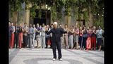 Designer Giorgio Armani accepts applause at the end of the Armani men's Spring-Summer 2020 collection, unveiled during the fashion week, in Milan, Italy, Monday, June 17, 2019. (AP Photo/Luca Bruno)