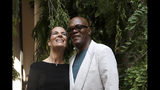 Actors Roberta Armani, left, and Samuel L. Jackson attend the Armani men's Spring-Summer 2020 collection, unveiled during the fashion week, in Milan, Italy, Monday, June 17, 2019. (AP Photo/Luca Bruno)