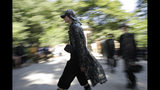 A model wears a creation as part of the Fendi men's Spring-Summer 2020 collection, unveiled during the fashion week, in Milan, Italy, Monday, June 17, 2019. (AP Photo/Luca Bruno)
