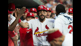 St. Louis Cardinals' Matt Carpenter is congratulated by teammates in the dugout after hitting a home run during the third inning of a baseball game against the Miami Marlins, Monday, June 17, 2019, in St. Louis. (AP Photo/L.G. Patterson)