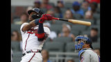 Atlanta Braves' Ronald Acuna Jr., left, follows through on a solo home run as New York Mets catcher Wilson Ramos, right, looks on in the first inning of a baseball game Monday, June 17, 2019, in Atlanta. (AP Photo/John Bazemore)