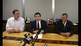 South Bend Mayor Pete Buttigieg, center, speaks during a news conference, Sunday, June 16, 2019, in South Bend, Ind., as South Bend Common Council President Tim Scott, left, and South Bend Police Chief Scott Ruszkowski, listen. Democratic presidential candidate Buttigieg changed his campaign schedule to return to South Bend for the late night news conference, after authorities say a man died after a shooting involving a police officer. (Santiago Flores/South Bend Tribune via AP)