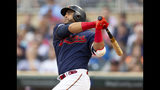 Minnesota Twins' Nelson Cruz hits a double against the Boson Red Sox in the first inning of a baseball game Monday, June 17, 2019, in Minneapolis. (AP Photo/Andy Clayton- King)