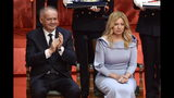 New Slovak President Zuzana Caputova, right, listens while outgoing President Andrej Kiska applauds during Caputova's inauguration ceremony at a parliamentary session in Bratislava, Slovakia, Saturday, June 15, 2019. (Vaclav Salek(Photographer/CTK via AP)