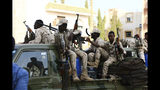 Military forces secure the area outside while Sudan's ousted president Omar al-Bashir is questioned at the prosecutor's office over charges of corruption and illegal possession of foreign currency, in Khartoum the capital of Sudan Sunday June 16, 2019. The deposed strongman has been held under arrest in the capital since the military removed him from power in April amid mass public protests against his 30-year rule.(AP Photo/Mahmoud Hjaj)