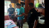 In this June 15, 2019, photo released by Crime Suppression Division, Italian Francesco Galdeli, center, is arrested by Thai police officers at a house in Chonburi. Thai police said they have arrested the Italian man wanted in his home country after fleeing a jail sentence handed down for fraudulently using the name of actor George Clooney to lure people into investing in a bogus clothing company. (Crime Suppression Division of Thailand via AP)