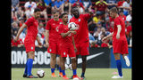 United States midfielder Duane Holmes, center, and forward Jozy Altidore, center right, meet on the field during warmups before an international friendly soccer match against Venezuela, Sunday, June 9, 2019, in Cincinnati. (AP Photo/John Minchillo)