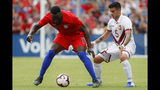 United States forward Jozy Altidore (17) and Venezuela midfielder Junior Moreno (5) vie for the ball during the second half of an international friendly soccer match, Sunday, June 9, 2019, in Cincinnati. (AP Photo/John Minchillo)