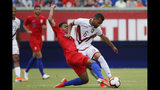 Venezuela midfielder Yangel Herrera (6) and United States midfielder Weston Mckennie (8) vie for the ball during the first half of an international friendly soccer match, Sunday, June 9, 2019, in Cincinnati. (AP Photo/John Minchillo)