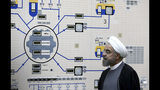 FILE - In this Jan. 13, 2015 file photo, released by the Iranian President's Office, President Hassan Rouhani visits the Bushehr nuclear power plant just outside of Bushehr, Iran. On Monday, June 17, 2019, Iran said it will break the uranium stockpile limit set by Tehran's nuclear deal with world powers in the next 10 days. (AP Photo/Iranian Presidency Office, Mohammad Berno, File)