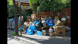 In this photo taken on Thursday, June 13, 2019, piles of trash are seen in the streets of Mostar, Bosnia. Uncollected thrash is piling up on the streets of the southern Bosnian city of Mostar - one of the Balkan nation's main tourist destinations - since residents begun blocking access to the city's sole landfill, insisting that it poses serious health and environmental risks. The landfill, located in a residential area, has operated since the 1960s. (Denis Leko/FENA via AP) MOSTAR, 13. juna (FENA) - (Foto FENA/Denis Leko)