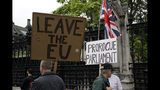 Brexit supporters holds placards as they protest outside the Houses of Parliament in London, Tuesday, June 18, 2019. All six contenders to replace British Prime Minister Theresa May as leader of the ruling Conservative party vow they will succeed where May failed and lead Britain out of the European Union, though they differ about how they plan to break the country's Brexit deadlock. (AP Photo/Matt Dunham)
