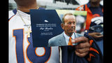 Denver Broncos fan Clinton Mayfield holds up a card to mark the five-hour memorial for team owner Pat Bowlen Tuesday, June 18, 2019 in at Mile High Stadium, the NFL football team's home in Denver. Bowlen, who has owned the franchise for more than three decades, died last Thursday. (AP Photo/David Zalubowski)