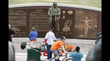 Fans gather at the foot of a statue at a five-hour memorial Denver Broncos owner Pat Bowlen Tuesday, June 18, 2019 in at Mile High Stadium, the NFL football team's home in Denver. Bowlen, who has owned the franchise for more than three decades, died last Thursday. (AP Photo/David Zalubowski)