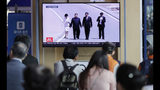 """People watch a TV news program reporting about Chinese President Xi Jinping's state visit to North Korea with file footage of Xi and North Korean leader Kim Jong Un, at the Seoul Railway Station in Seoul, South Korea, Tuesday, June 18, 2019. The letters on the top read """"Chinese President Xi Jinping will visit Pyongyang on June 20"""". (AP Photo/Lee Jin-man)"""