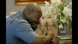 In this Friday, June 14, 2019 photo, Chris Parks wipes away a tear while talking about the murder of his brother Donovan Corey Parks in Powder Springs, Ga.. Marion Wilson Jr. and Robert Earl Butts Jr. were convicted of murder and sentenced to death in the March 1996 killing of 24-year-old Donovan Corey Parks. Butts was executed in May 2018. Wilson, who's 42, is set for execution Thursday, June 20. (AP Photo/Andrea Smith)