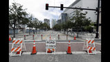 Road closures are seen around the Amway Center, right, on Monday, June 17, 2019 the site of a Tuesday night rally for President Donald Trump, in Orlando, Fla. (AP Photo/John Raoux)