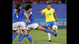 Italy's Sara Gama, center, tries to block a shot from Brazil's Marta during the Women's World Cup Group C soccer match between Italy and Brazil at the Stade du Hainaut in Valenciennes, France, Tuesday, June 18, 2019. (AP Photo/Michel Spingler)