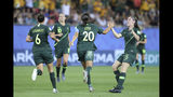 Australia's Sam Kerr, second right, celebrates after scoring her side's second goal during the Women's World Cup Group C soccer match between Jamaica and Australia at Stade des Alpes stadium in Grenoble, France, Tuesday, June 18, 2019. (AP Photo/Laurent Cipriani)