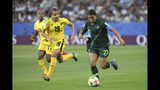Australia's Sam Kerr, right, scores her side's opening goal during the Women's World Cup Group C soccer match between Jamaica and Australia at Stade des Alpes stadium in Grenoble, France, Tuesday, June 18, 2019. (AP Photo/Laurent Cipriani)
