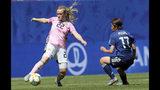 Scotland's Erin Cuthbert, left, is challenged by Japan's Narumi Miura during the Women's World Cup Group D soccer match between Japan and Scotland at the Roazhon Park in Rennes, France, Friday, June 14, 2019. (AP Photo/David Vincent)