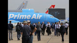 "Visitors walk past an Boeing 737-800 BCF Amazon ""Prime Air"" cargo plane at Paris Air Show, in Le Bourget, east of Paris, France, Tuesday, June 18, 2019. The world's aviation elite are gathering at the Paris Air Show with safety concerns on many minds after two crashes of the popular Boeing 737 Max. (AP Photo/Michel Euler)"