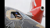 A pilot of an Embraer Profit Hunter E195-E2 makes the thumbs up sign as he on the tarmac at Paris Air Show, in Le Bourget, east of Paris, France, Tuesday, June 18, 2019. The world's aviation elite are gathering at the Paris Air Show with safety concerns on many minds after two crashes of the popular Boeing 737 Max. (AP Photo/Michel Euler)