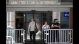 Police officers guard the Anti-Corruption Office of the Judicial Police headquarters in Nanterre, outside Paris,Tuesday, June 18, 2019. Former UEFA president Michel Platini has been arrested in relation to a corruption probe into the awarding of the 2022 World Cup to Qatar, a judicial official said Tuesday. (AP Photo/Christophe Ena)