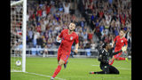United States' Paul Arriola (7) celebrates after scoring a goal agains Guyana goalie Akel Clarke (1) during the first half of a CONCACAF Gold Cup soccer match Tuesday, June 18, 2019, in St. Paul, Minn. (AP Photo/Andy Clayton- King)