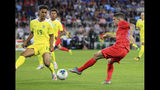 United States' Jordan Morris (11) shoots past Guyana's Terence Vancooten (15) during the first half of a CONCACAF Gold Cup soccer match Tuesday, June 18, 2019, in St. Paul, Minn. (AP Photo/Andy Clayton- King)