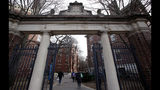 FILE - In this Dec. 13, 2018, file photo, a gate opens to the Harvard University campus in Cambridge, Mass. The Ivy League university announced Monday, June 17, 2019, that it would revoke an admission offer to a survivor of the Parkland high school massacre because of racist social media posts. The decision serves as a reminder to aspiring college students and all young people that their online comments, even those considered private, can resurface and be used against them. (AP Photo/Charles Krupa, File)