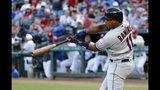 Cleveland Indians' Jose Ramirez hits a three-run home run off Texas Rangers' Adrian Sampson during the third inning of a baseball game in Arlington, Texas, Tuesday, June 18, 2019. (AP Photo/Tony Gutierrez)