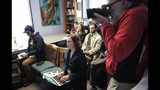 In this Tuesday, April 9, 2019 photo Berkshire Eagle reporter Heather Bellows, seated center, and Eagle photographer Ben Garver, standing at right, attend a news conference with Berkshire County District Attorney Andrea Harrington, not shown, in Pittsfield, Mass. Bellow was recruited as an investigative reporter two years ago as part of a hiring flurry that brought dozens of new jobs to The Berkshire Eagle and its three sister Vermont papers. (AP Photo/Steven Senne)