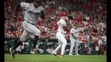 St. Louis Cardinals relief pitcher Tyler Webb, center, throws out Miami Marlins' Rosell Herrera during the eighth inning of a baseball game Tuesday, June 18, 2019, in St. Louis. (AP Photo/L.G. Patterson)