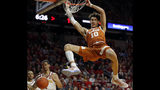 FILE - In this Feb. 2, 2019, file photo, Texas forward Jaxson Hayes (10) dunks the ball over Iowa State guard Nick Weiler-Babb, left, during the first half of an NCAA college basketball game, in Ames, Iowa. Hayes needed only a year at Texas to put himself at the front of the class of big men in the NBA draft coming Thursday, June 20, 2019. (AP Photo/Charlie Neibergall, File)