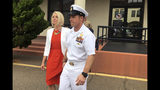 FILE - In this Thursday, May 30, 2019, file photo, Navy Special Operations Chief Edward Gallagher leaves a military courtroom on Naval Base San Diego with his wife, Andrea Gallagher, in San Diego. Edward Gallagher, who has been charged with allegedly killing an Islamic State prisoner in his care and attempted murder for the shootings of two Iraq civilians in 2017, is scheduled to go on trial Monday, June 17, 2019. (AP Photo/Julie Watson, File)