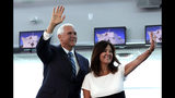 Vice President Mike Pence and his wife Karen wave following a tour on the USNS Comfort, Tuesday, June 18, 2019, in Miami. The hospital ship is scheduled to embark on a five-month medical assistance mission to Latin America and the Caribbean, including several countries struggling to absorb migrants from crisis-wracked Venezuela. (AP Photo/Lynne Sladky)