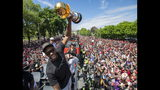 Toronto Raptors' Kawhi Leonard celebrates during the team's NBA basketball championship parade in Toronto, Monday, June 17, 2019. (Frank Gunn/The Canadian Press via AP)